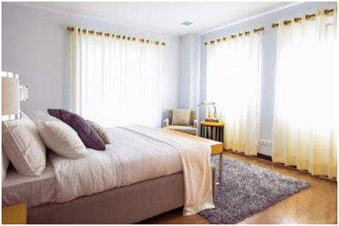 Having your bed made not only pulls the room together, but it makes you look pulled together as well.